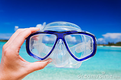 Snorkel googles against beach and sky