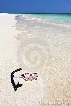 Snorkel and mask on paradise beach.
