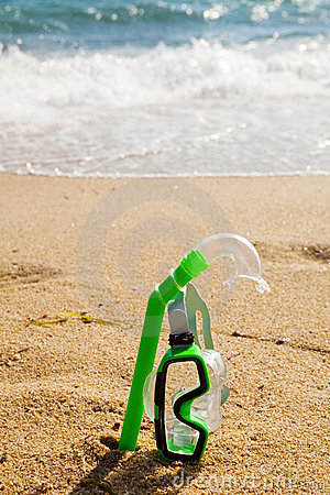 Snorkel and mask in sand