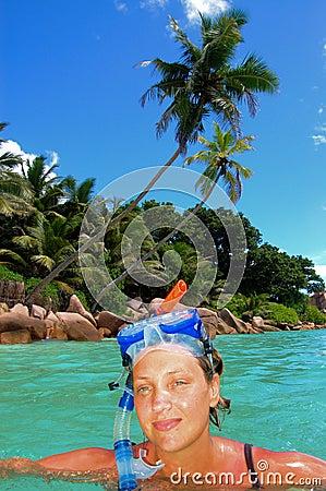 Snorkeler on tropical island