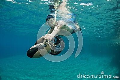 Snorkeler on underwater scooter