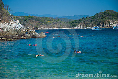 Snorkeling at a beach. Huatulco, Oaxaca, Mexico