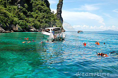 Snorkeling tourists on turquoise water Editorial Stock Image