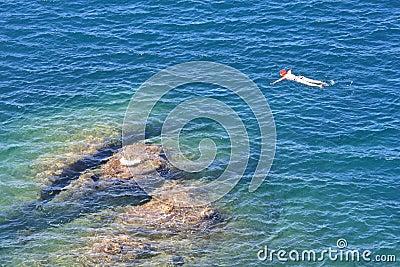 Snorkeling in the Tyrrenian Sea near Talamone, Italy Editorial Photo