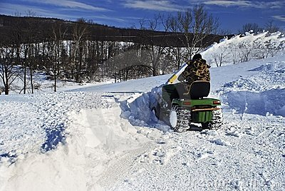 Snow Blower man clearing driveway