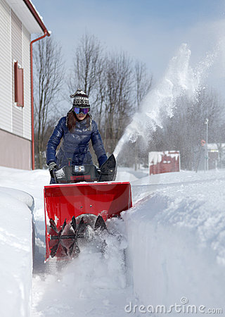 Snow blowing girl
