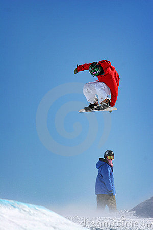 Snow boarders jumping,