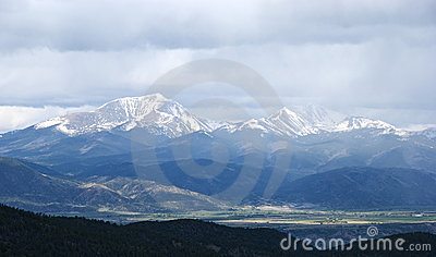 Snow Capped Mountains Shrouded in Storm Clouds