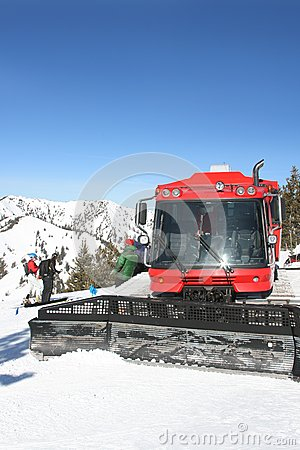 Snow-cat with skiers in winter