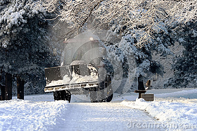 Snow cleaning  tractor clears paths