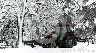 Snow cleaning tractor clears paths Editorial Photography