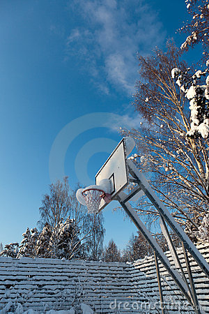 Snow covered basketball court on a cloudless winter day. By Kristian ...