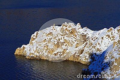 Snow covered coastal cliffs