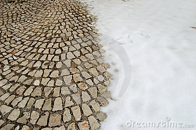 Snow-covered cobblestone floor