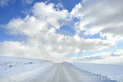 Snow covered country roa