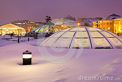 Snow covered glass cupola on Manege square, Moscow