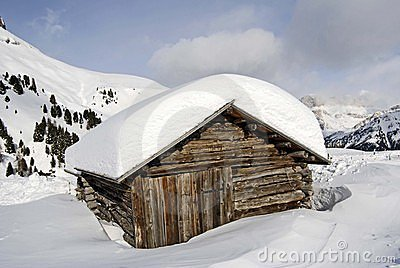 Snow covered mountain cabin