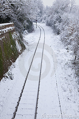 Snow Covered Railway Tracks and Stop Light