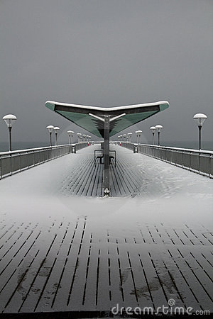 Snow covered retro pier at boscombe