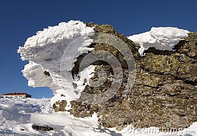Snow-covered rocks against blue sky.Siberia.Taiga.