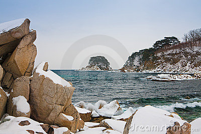 Snow-covered rocks at the sea