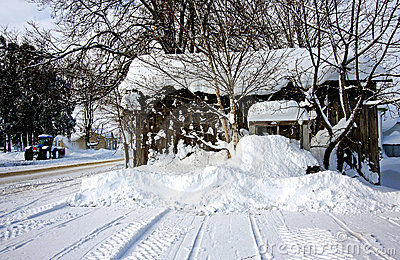 A snow-covered shed