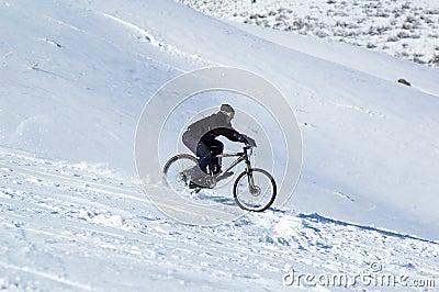 Snow downhill on bike
