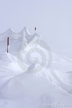Snow drift at top of mountain