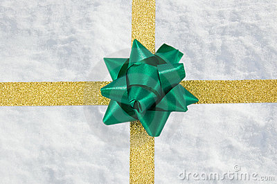 Snow gift with golden ribbon