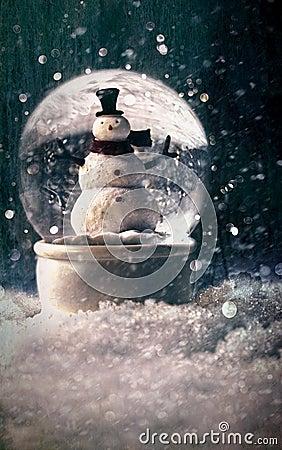 Snow globe in a snowy winter setting