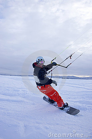 Snow kiting on snowboard.