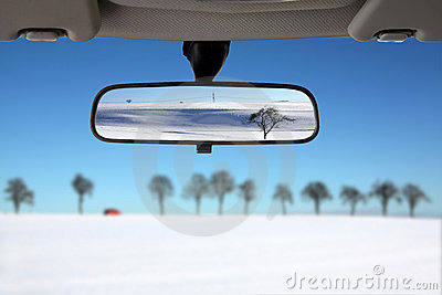 Snow Landscape reflected in car rear mirror