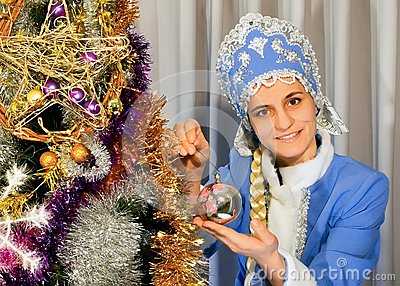Snow Maiden decorates a Christmas tree