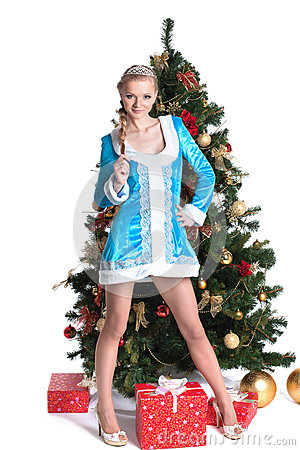 Snow Maiden posing with Christmas tree and gifts