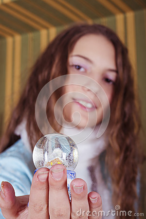 Snow-maiden showing snow globe