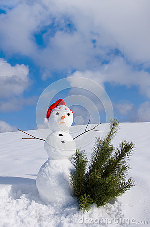 Snow man in santa cap