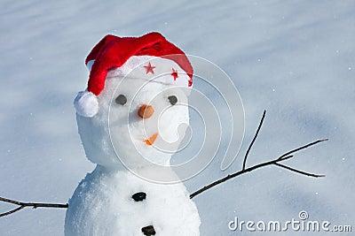 Snow man in santa cap