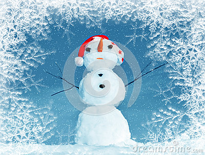 Snow man in santa cap in frame