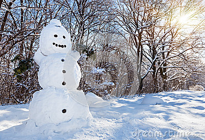 Snow man in winter forest