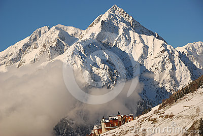 Snow mountain alps and village