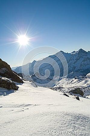 Snow mountain peak sunshine