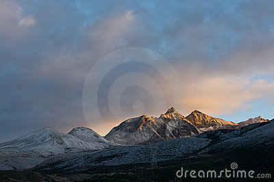 Snow mountain in sunrise sunshine