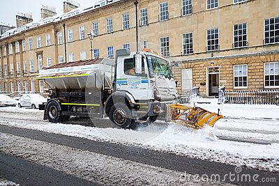 Snow Plough Clears Street in Bath, UK Editorial Image