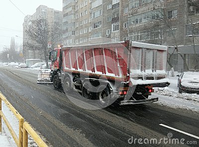 Snow plow - heavy winter road traffic Stock Photo