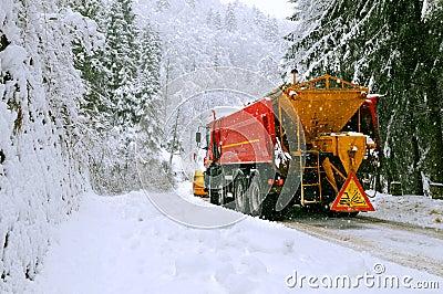 Snow plow truck in winter