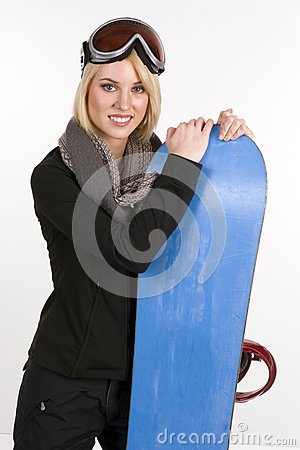 Snow Ready Woman Poses Next to Snow Board