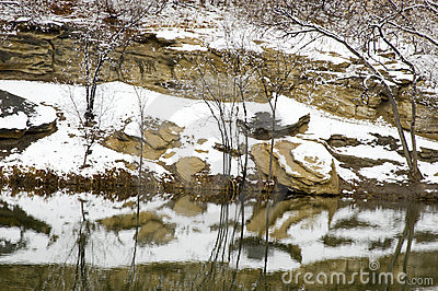Snow reflected in a Pond
