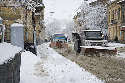 Snow-removal machine cleans the street of snow Editorial Photo