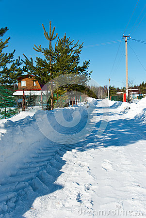 Snow-removed road in countryside