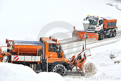 Snow remover trucks at work Editorial Photo